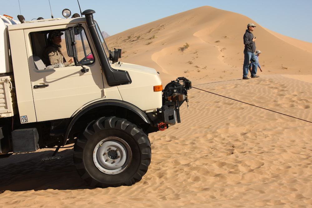 Winching other         unimogs in the high dunes